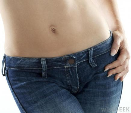 close-view-of-persons-stomach-and-lower-body-in-jeans